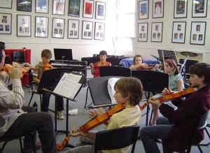 Seniors learning about the violin